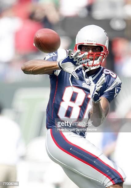 Randy Moss of the New England Patriots catches a pass in warmup before a game against the New York Jets during their game on September 9 2007 at...