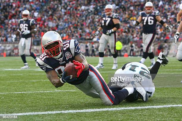 Randy Moss of the New England Patriots catches his third touchdown pass of the day against the Jacksonville Jaguars in the fourth quarter at Gillette...