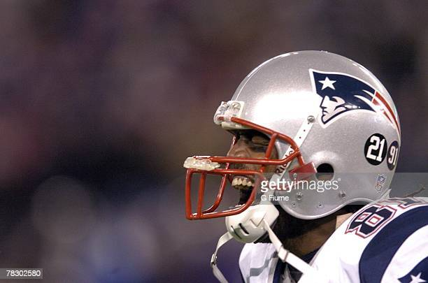 Randy Moss of the New England Patriots celebrates after the Patriots score the winning touchdown against the Baltimore Ravens on December 3 2007 at...