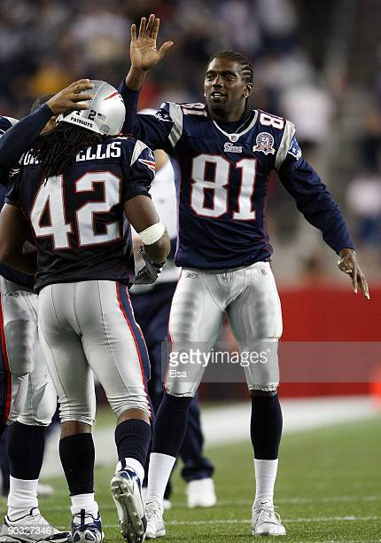Randy Moss of the New England Patriots congratulates BenJarvus GreenEllis after he scored a touchdown in the fourth quarter against the New York...