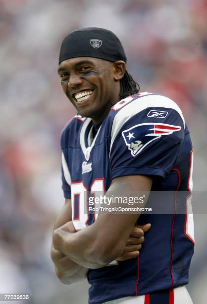 Randy Moss of the New England Patriots laughs against the Cleveland Browns at Gillette Stadium on October 7, 2007 in Foxborough, Massachusetts. The...