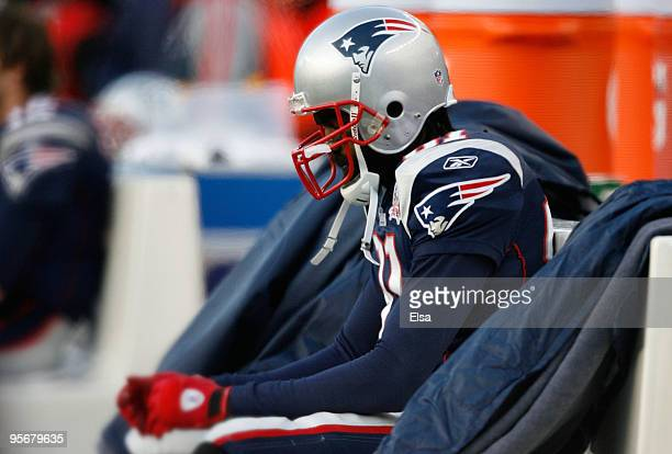 Randy Moss of the New England Patriots sits on the bench dejected late in the fourth quarter against the Baltimore Ravens during the 2010 AFC...
