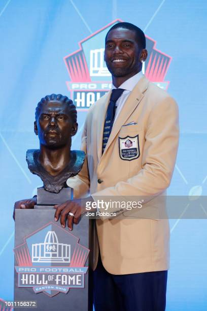 Randy Moss poses with his bust during the 2018 NFL Hall of Fame Enshrinement Ceremony at Tom Benson Hall of Fame Stadium on August 4 2018 in Canton...