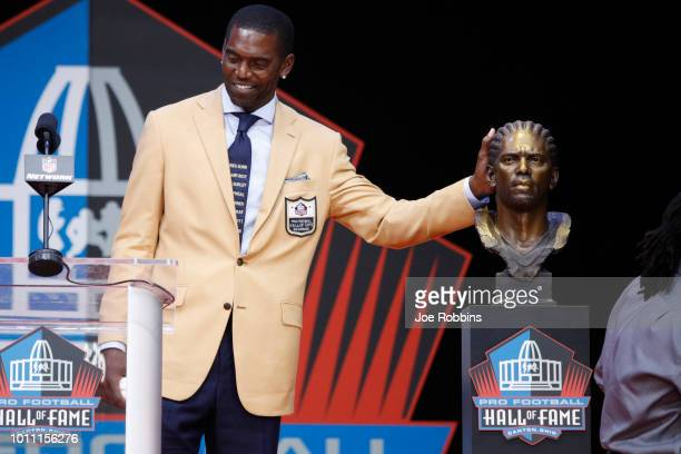 Randy Moss reacts during the 2018 NFL Hall of Fame Enshrinement Ceremony at Tom Benson Hall of Fame Stadium on August 4, 2018 in Canton, Ohio.