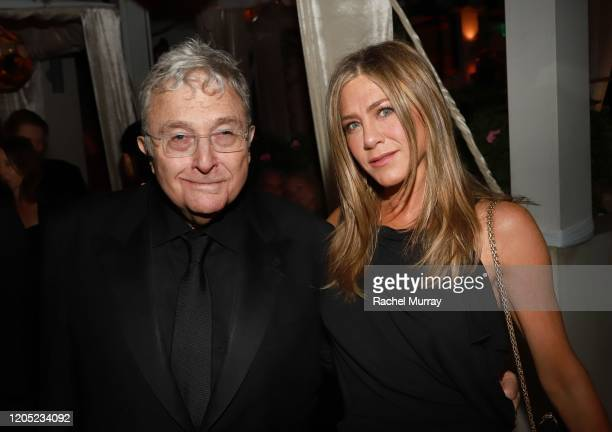 Randy Newman and Jennifer Aniston attend the 2020 Netflix Oscar After Party at San Vicente Bugalows on February 09 2020 in West Hollywood California
