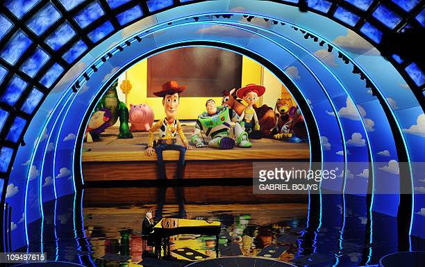 Randy Newman performs his nominated song We Belong Together from the animated film Toy Story 3 on stage at the 83rd Annual Academy Awards held at the...