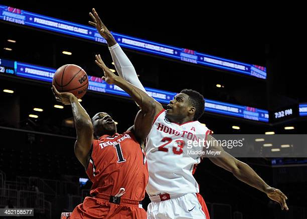 Randy Onwuasor of the Texas Tech Red Raiders looks for a shot over Danuel House of the Houston Cougars during the first half at Barclays Center on...