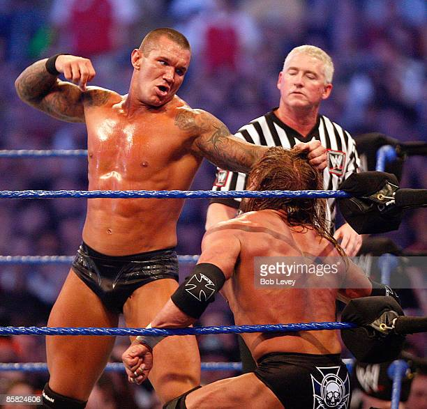Randy Orton and Triple H battle during their WWE Championship match at 'WrestleMania 25' >> at the Reliant Stadium on April 5 2009 in Houston Texas