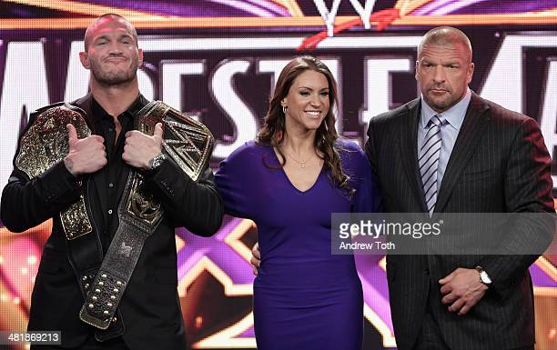 Randy Orton Stephanie McMahon and Triple H attend the WrestleMania 30 press conference at the Hard Rock Cafe New York on April 1 2014 in New York City