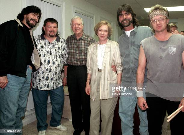 Randy Owen and Jeff Cook of Country Group Alabama Former President Jimmy Carter Former First Lady Rosalynn Carter Teddy Gentry and Mark Heardon of...