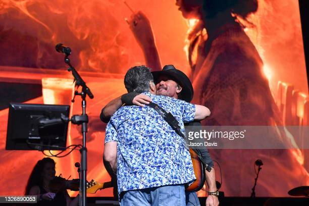 Randy Owen and special guest Tim McGraw hug on stage during the Alabama 50th Anniversary Tour Opening Weekend at Bridgestone Arena on July 03, 2021...