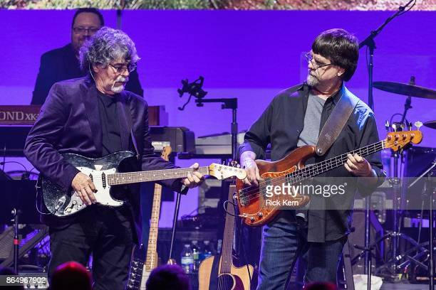 Randy Owen and Ted Gentry of Alabama perform onstage during the 'Deep from the Heart The One America Appeal Concert' at Reed Arena on the campus of...