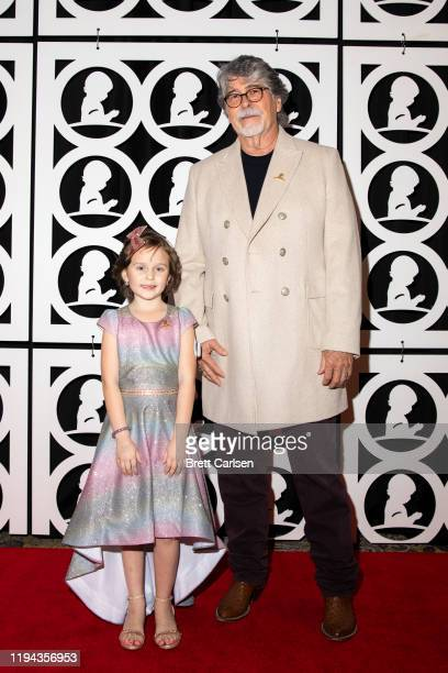 Randy Owen of Alabama poses on the red carpet with St Jude patient Londyn during Country Cares for St Jude Kids Seminar at The Peabody on January 17...