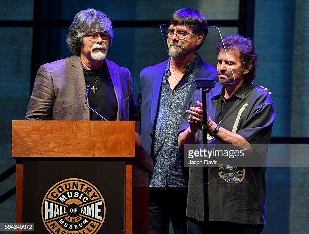 Randy Owen Teddy Gentry and Jeff Cook of the band Alabama speak during the debut of the 'Alabama Song of the South' exhibition at Country Music Hall...