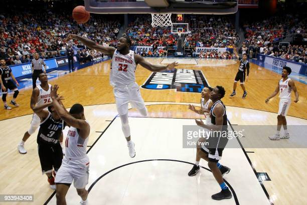 Randy Phillips of the Radford Highlanders blocks a shot from Jashaun Agosto of the LIU Brooklyn Blackbirds during the game at UD Arena on March 13...