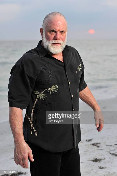 Randy Poffo known by his ring name Macho Man Randy Savage poses for a photograph following his wedding to Lynn Payne on the beach May 10 2010 in...