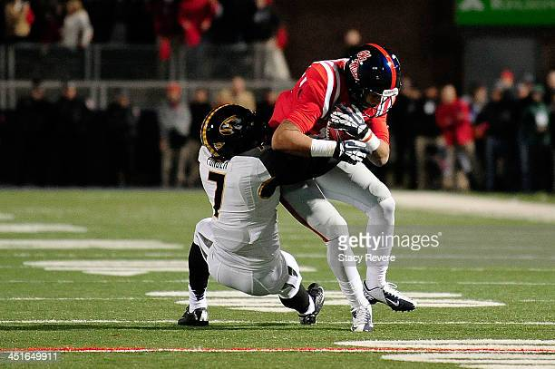Randy Ponder of the Missouri Tigers tackles Donte Moncrief of the Ole Miss Rebels during a game at Vaught-Hemingway Stadium on November 23, 2013 in...