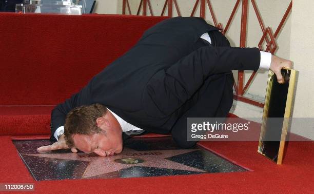 Randy Quaid kisses his star on the Hollywood Walk of Fame