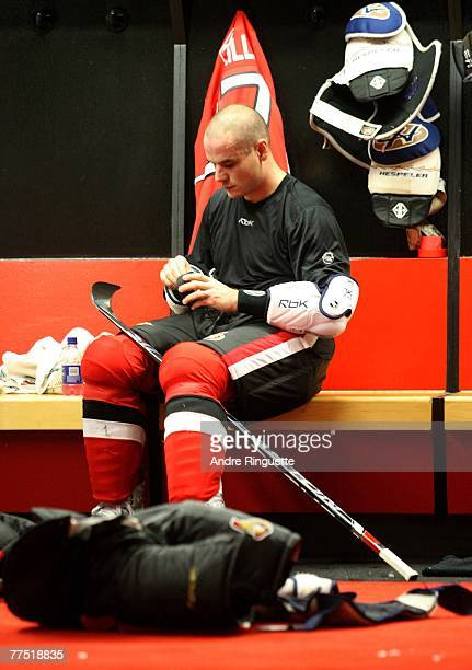 Randy Robitaille of the Ottawa Senators tapes his stick in the locker room before a game against the Florida Panthers at Scotiabank Place on October...