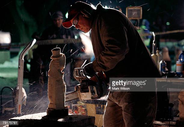 Randy Rupert uses a chainsaw to carve a Groundhog statue out of a log during festivities February 1 2007 in Punxsutawney Pennsylvania Groundhog Day...