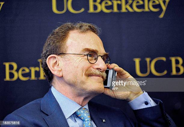 Randy Schekman takes a call from University of California president Janet Napolitano at the University of California Berkeley at the conclusion of a...