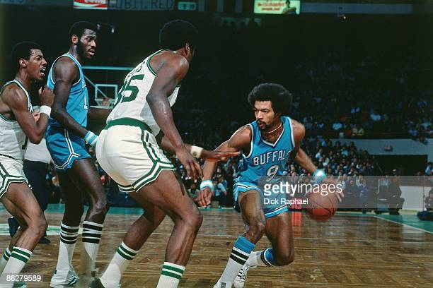 Randy Smith of the Buffalo Braves makes a move against Paul Silas of the Boston Celtics during a game played in 1976 at the Boston Garden in Boston...