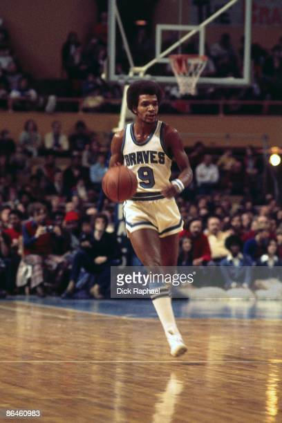 Randy Smith of the Buffalo Braves moves the ball up court against the Boston Celtics during a game played in 1974 at the Boston Garden in Boston...