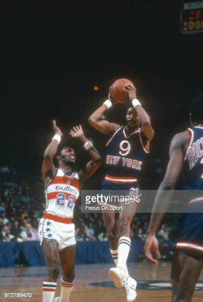 Randy Smith of the New York Knicks looks to pass the ball over Don Collins of the Washington Bullets during an NBA basketball game circa 1981 at the...