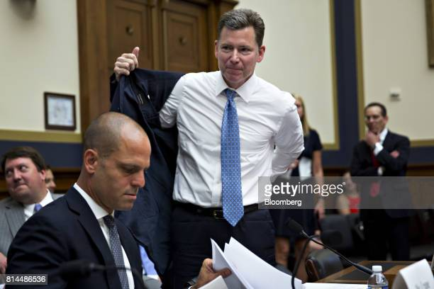 Randy Snook executive vice president of the Securities Industry and Financial Markets Association center puts on his jacket before the start of a...