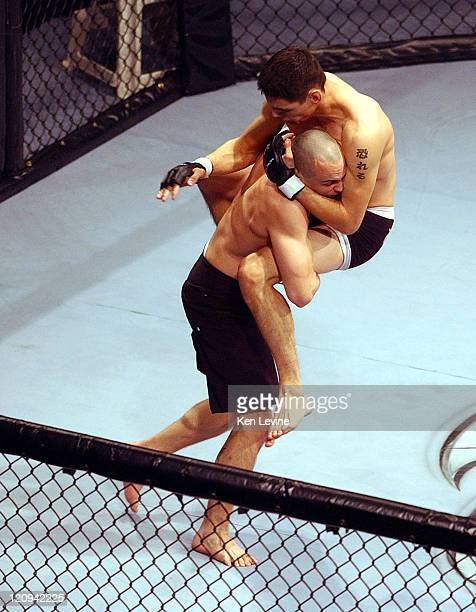 Randy Spence, left, lifts Cole Escovedo, right and prepares to throw him down to the canvas during the IFC Caged Combat fights at the E Center in...