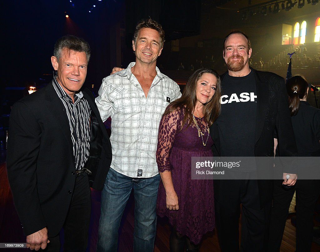 Randy Travis, John Schneider, Carlene Carter and John Carter Cash attend the Johnny Cash Limited-Edition Forever Stamp launch at Ryman Auditorium on June 5, 2013 in Nashville, Tennessee.
