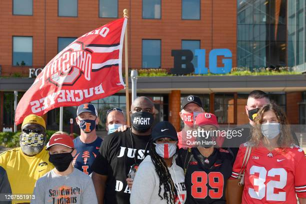 Randy Wade, father of Shaun Wade of the Ohio State Buckeyes, and Big Ten parents pose for photo during a rally outside to the Big Ten Conference...