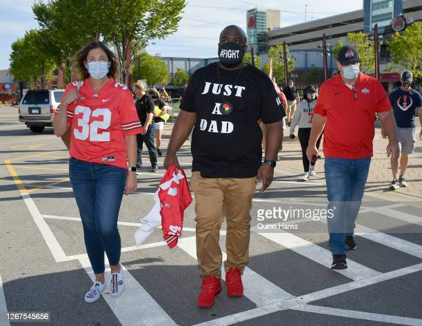 Randy Wade father of Shaun Wade of the Ohio State Buckeyes marches during a parent rally outside of the Big Ten Conference headquarters on August 21...