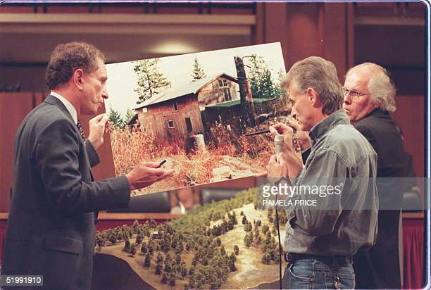 Randy Weaver shows a model of his Ruby Ridge Idaho cabin to US Senator Arlen Specter RPA 06 September on Capitol Hill during Senate hearings...
