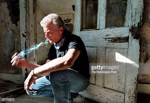 Randy Weaver takes a drag on his cigarette as he pauses in a moment of contemplation in an abandoned farm house near his home in Jefferson Iowa When...