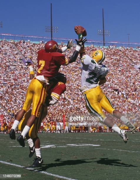 Randy Willhite, Running Back for the University of Oregon Ducks jumps in the air to catch the football from Mark Carrier, Safety for the University...