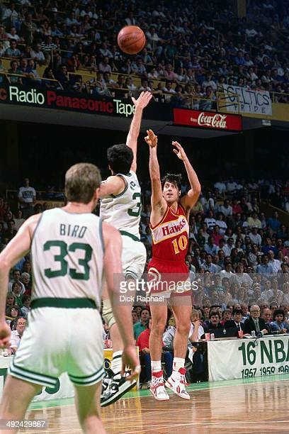 Randy Wittman of the Åtlanta Hawks shoots against Kevin McHale of the Boston Celtics during a game played in 1988 at the Boston Garden in Boston...