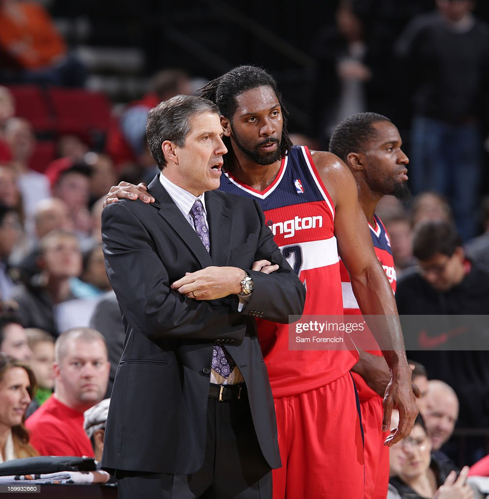 Randy Wittman of the Washington Wizards and Nene #42 of the Washington Wizards discuss a play during the game against the Portland Trail Blazers on January 21, 2013 at the Rose Garden Arena in Portland, Oregon.
