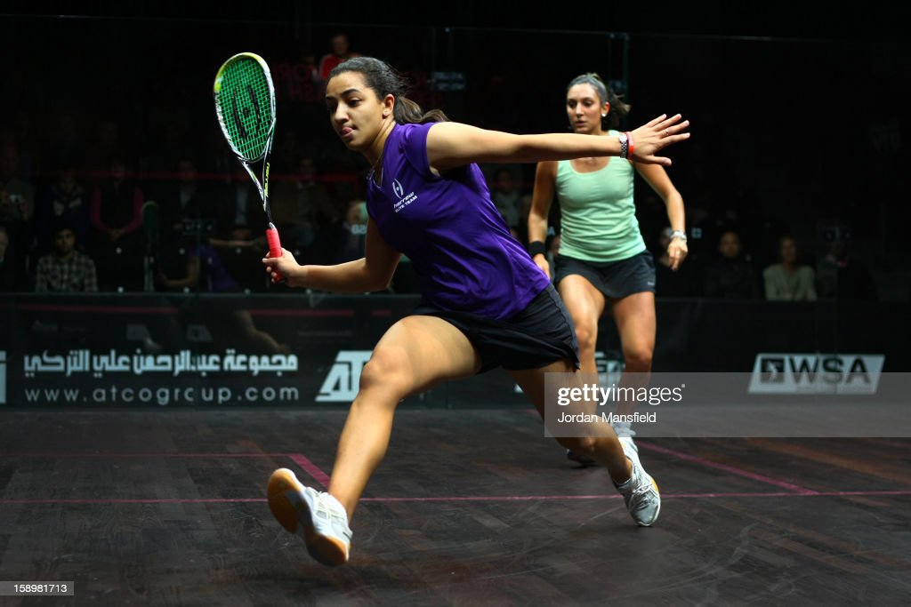 Raneem El Weleily of Egypt in action against Camille Serme of France during Day 3 of the World Series Finals helf at Queens Club on January 4, 2013 in London, England.