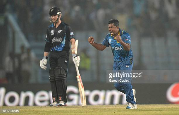Rangana Herath of Sri Lanka celebrates dismissing Jimmy Neesham of New Zealand during the ICC World Twenty20 Bangladesh 2014 Group 1 match between...