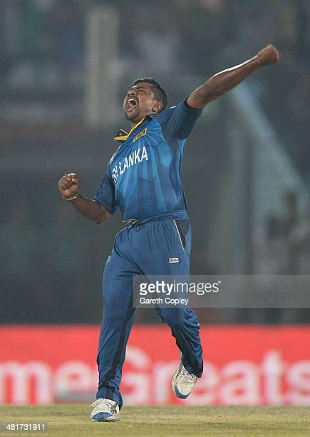 Rangana Herath of Sri Lanka celebrates dismissing Luke Ronchi of New Zealand during the ICC World Twenty20 Bangladesh 2014 Group 1 match between Sri...
