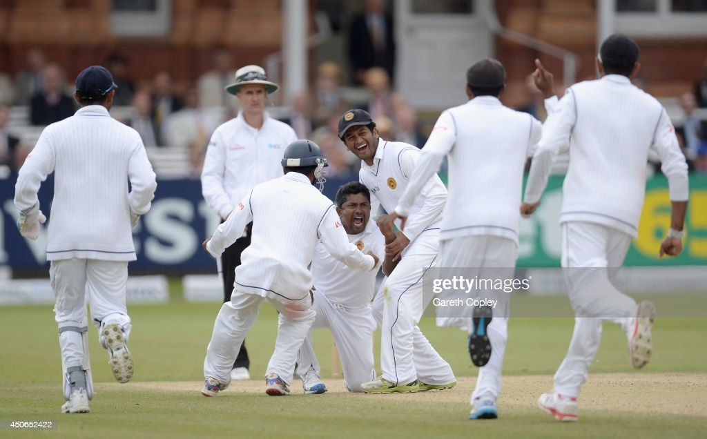 Rangana Herath of Sri Lanka celebrates dismissing Moeen Ali of England during day four of 1st Investec Test match between England and Sri Lanka at Lord's Cricket Ground on June 15, 2014 in London, England.