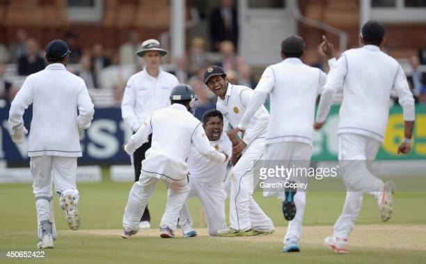 Rangana Herath of Sri Lanka celebrates dismissing Moeen Ali of England during day four of 1st Investec Test match between England and Sri Lanka at...
