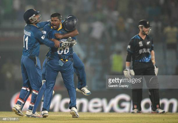 Rangana Herath of Sri Lanka celebrates with teammates after dismissing Jimmy Neesham of New Zealand during the ICC World Twenty20 Bangladesh 2014...
