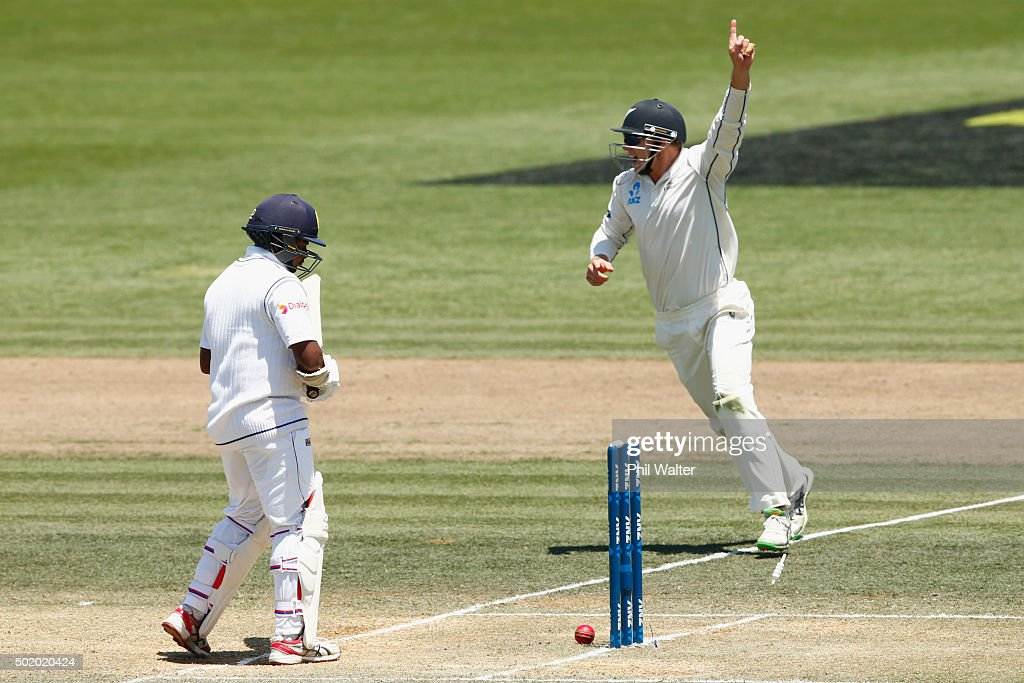 Rangana Herath of Sri Lanka is bowled by Tim Southee as Tom Latham celebrates during day three of the Second Test match between New Zealand and Sri Lanka at Seddon Park on December 20, 2015 in Hamilton, New Zealand.