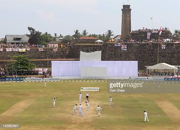 Rangara Herath of Sri Lanka celebrates taking the wicket of Graeme Swann of England during day 4 of the 1st test match between Sri Lanka and England...