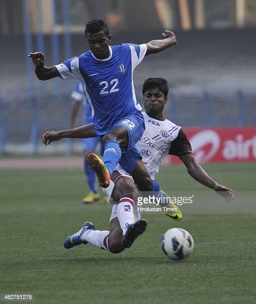 Rangdajied United Fc Munmun TO lugun in action defending the Mohun Bagan Player Pritam Kotla during the ILeague Match at Vivekananda Yuba Bharti...