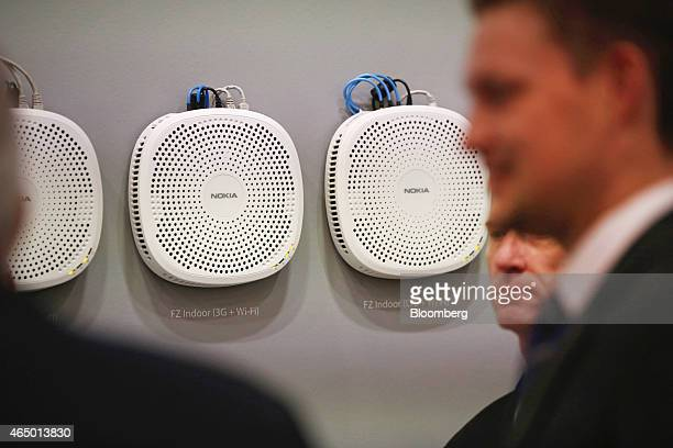 A range of FZ indoor digital network devices for 3G WiFi and LTE manufactured by Nokia Solutions and Networks sit on display in the Nokia Oyj...
