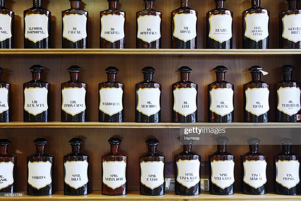 A range of natural spirits, acids and oils in homeopathic pharmacy : Stock Photo