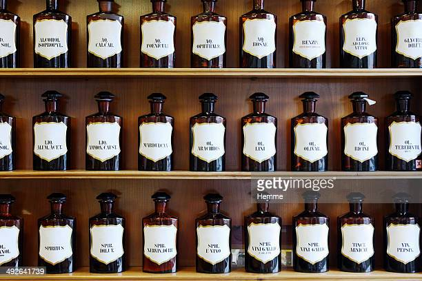 a range of natural spirits, acids and oils in homeopathic pharmacy - alternatieve geneeswijzen stockfoto's en -beelden